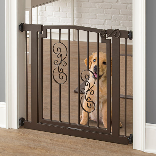 Noblesse Dog Gate in Mocha Pressure Mounted Decorative Heavy Duty Metal Walk Thru Door Shown With Puppy