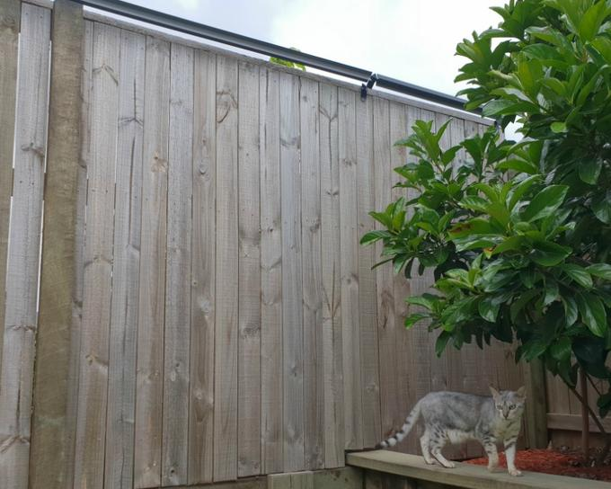 Oscillot cat proof fence containment system to cat proof your backyard with wooden fence