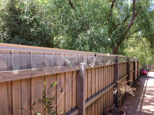 Oscillot cat containment system (Merino) on timber fence with polycarbonate
