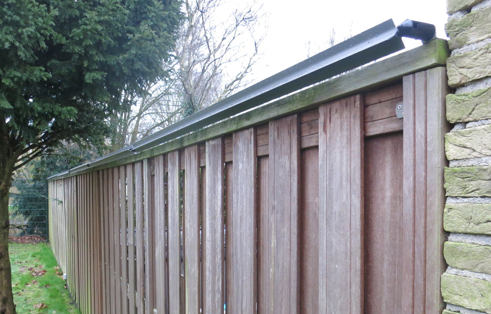 Oscillot cat containment system (Slate Grey) on timber fence