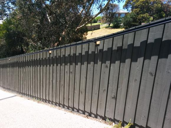 Oscillot cat containment system (Slate Grey) on timber fence with brackets
