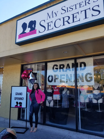 Kahlilah Dawkins Owner of My Sister's Secrets standing in front of store on grand opening