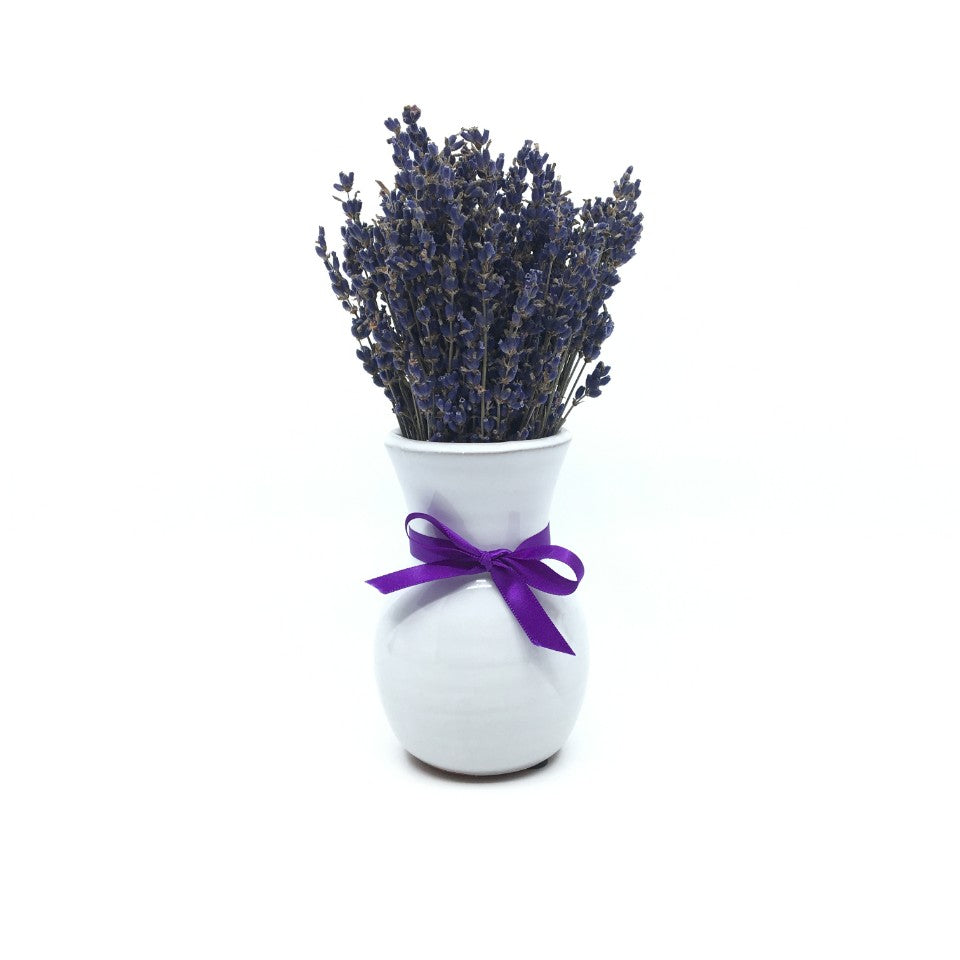 Dried lavender bouquet in white ceramic vase