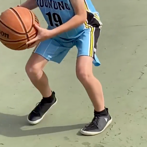 Andy's son wearing Vivobarefoot while he plays basketball. | Sole Mechanics Blog