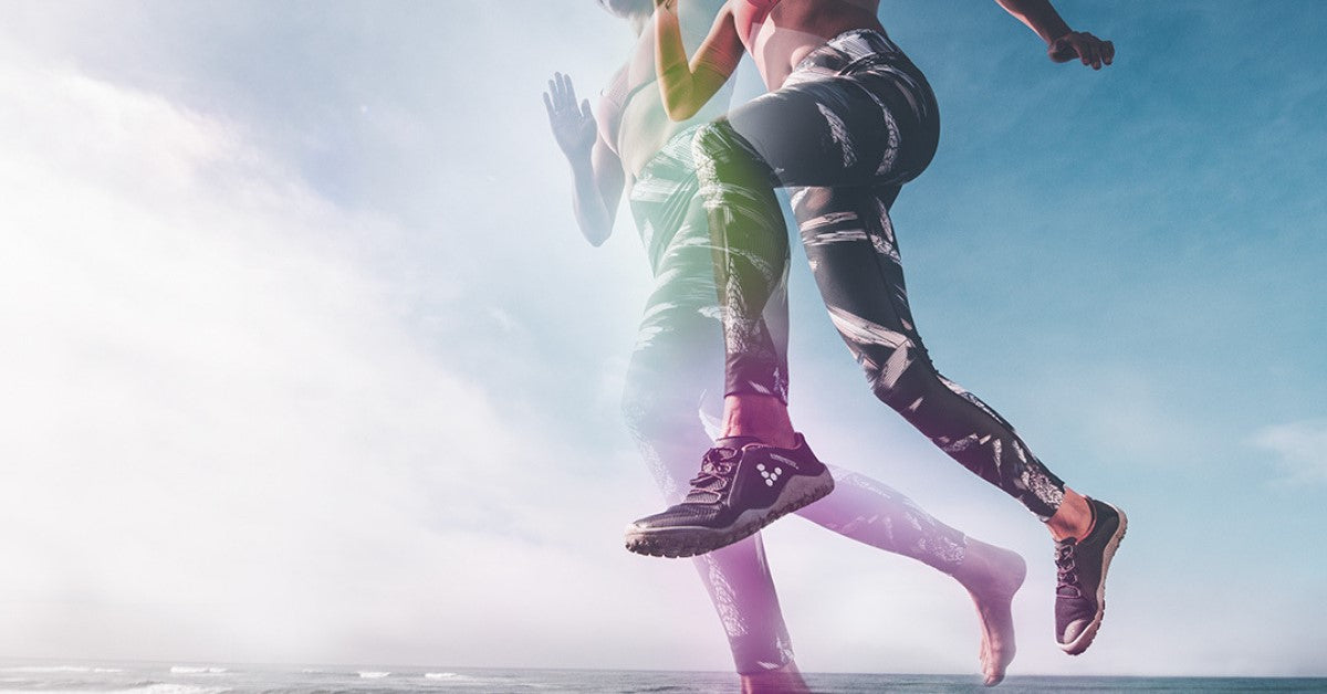 Woman jumping with trainers on