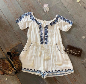 White romper with blue embroidery