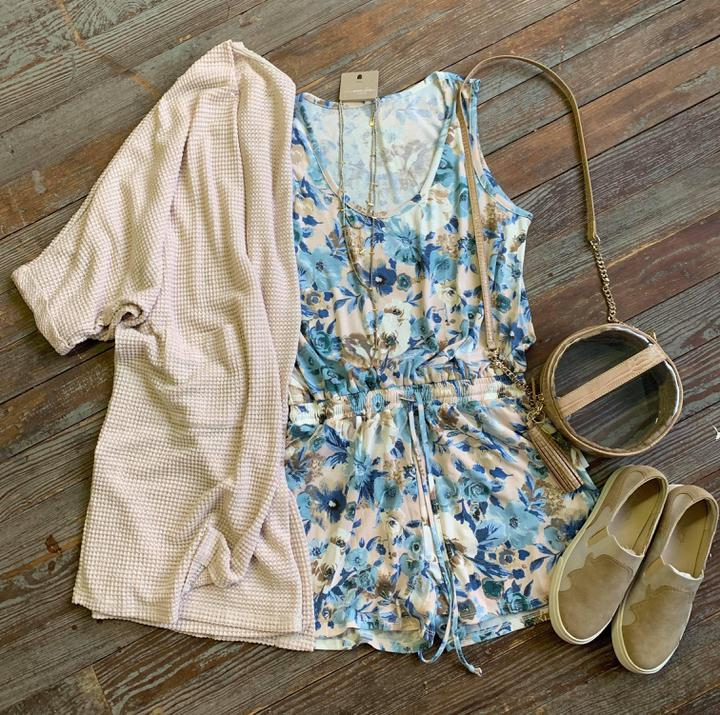 floral romper with pockets and waist tie
