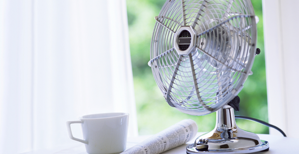 Ventilator, cup and newspaper