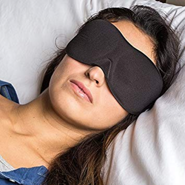 Girl sleeping with a sleep mask