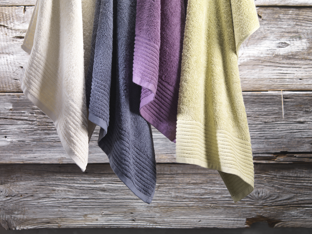 too hot to sleep: Hand towels against a wooden background