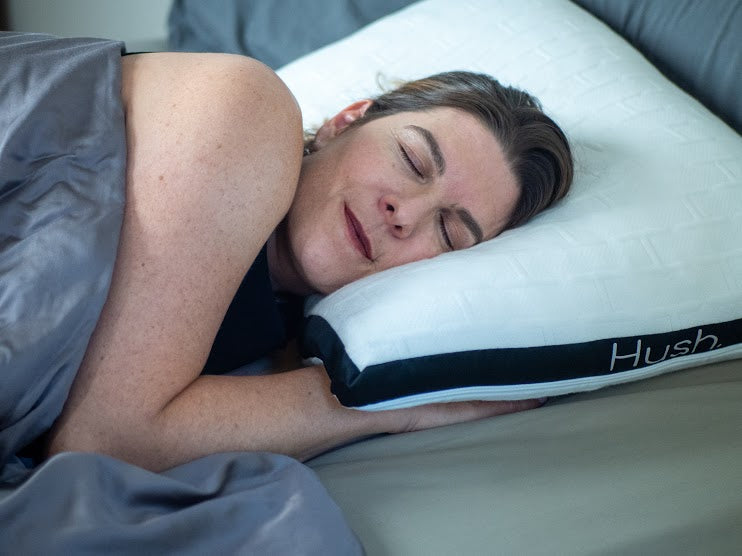 Woman sleeping under a weighted blanket