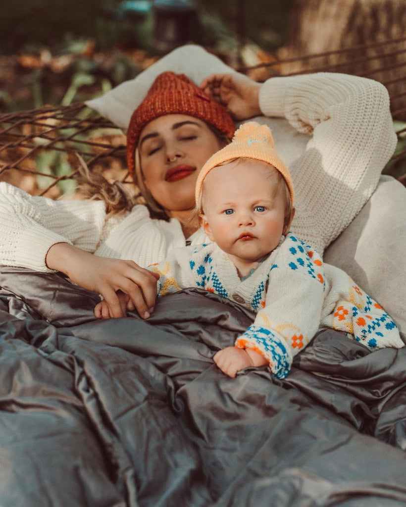 Mother and child on a hammock with a blanket