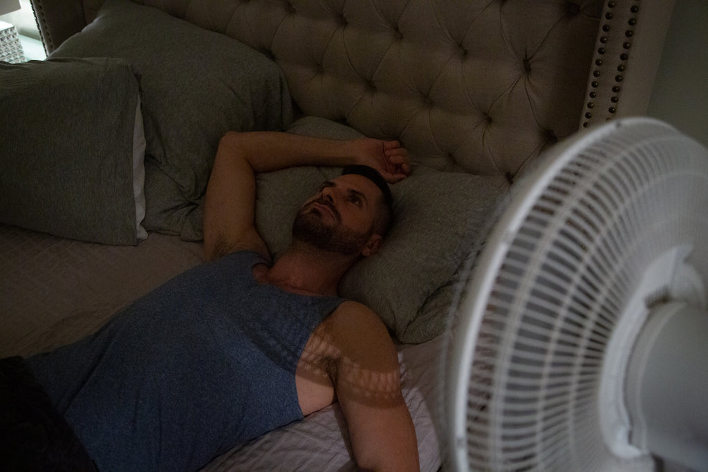 tossing and turning: man laying in bed