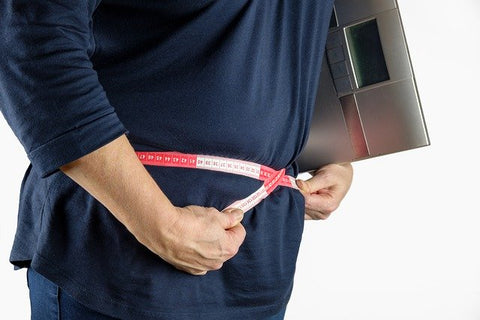 overweight man with tape measurer