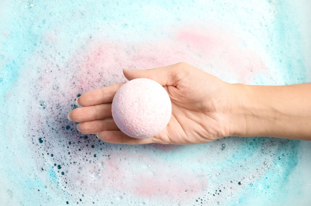 Stress relief gifts: Person holding a bath bomb