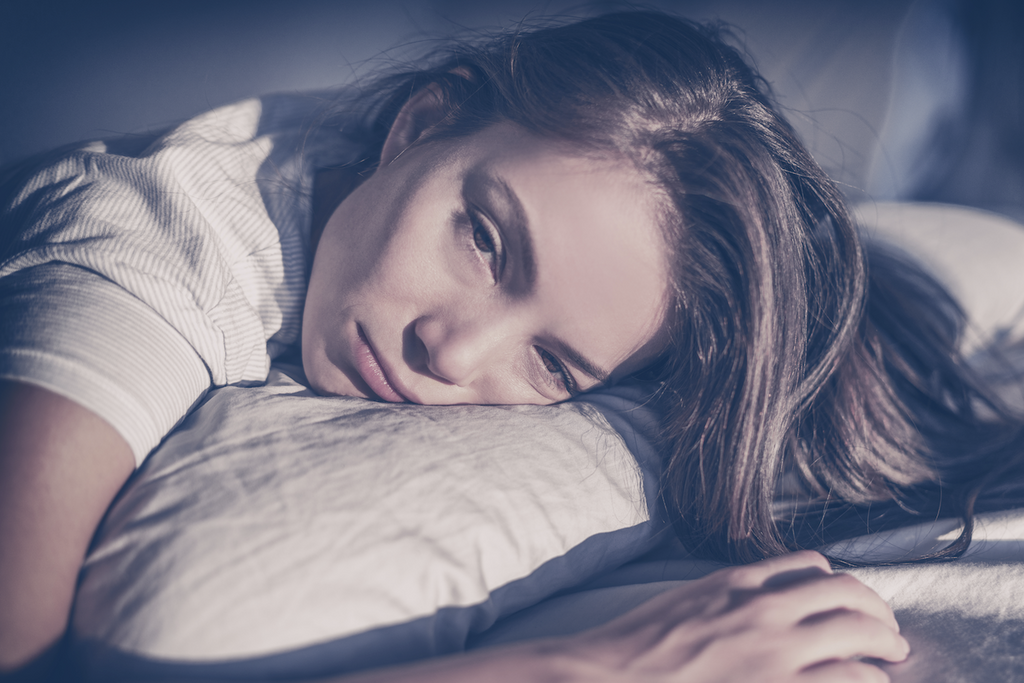 tossing and turning: woman laying in bed