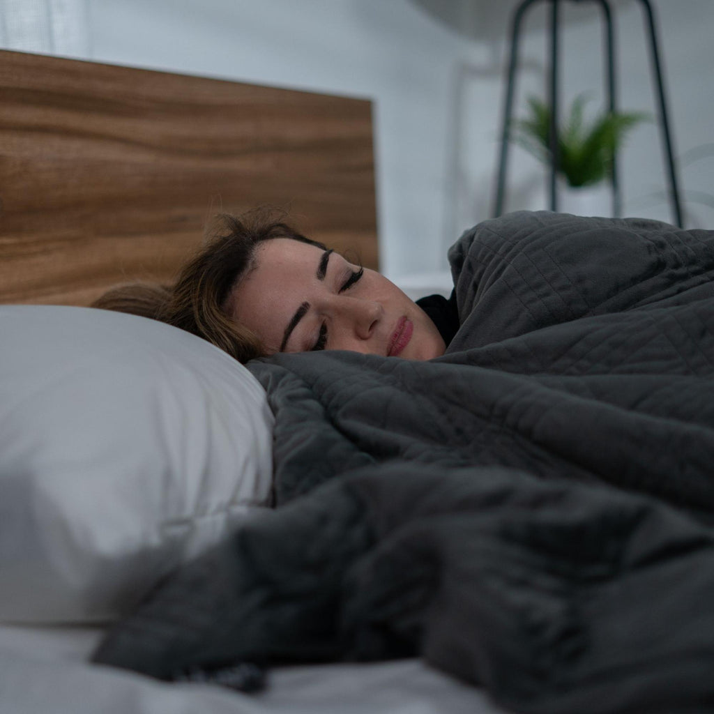 Woman sleeping with a blanket