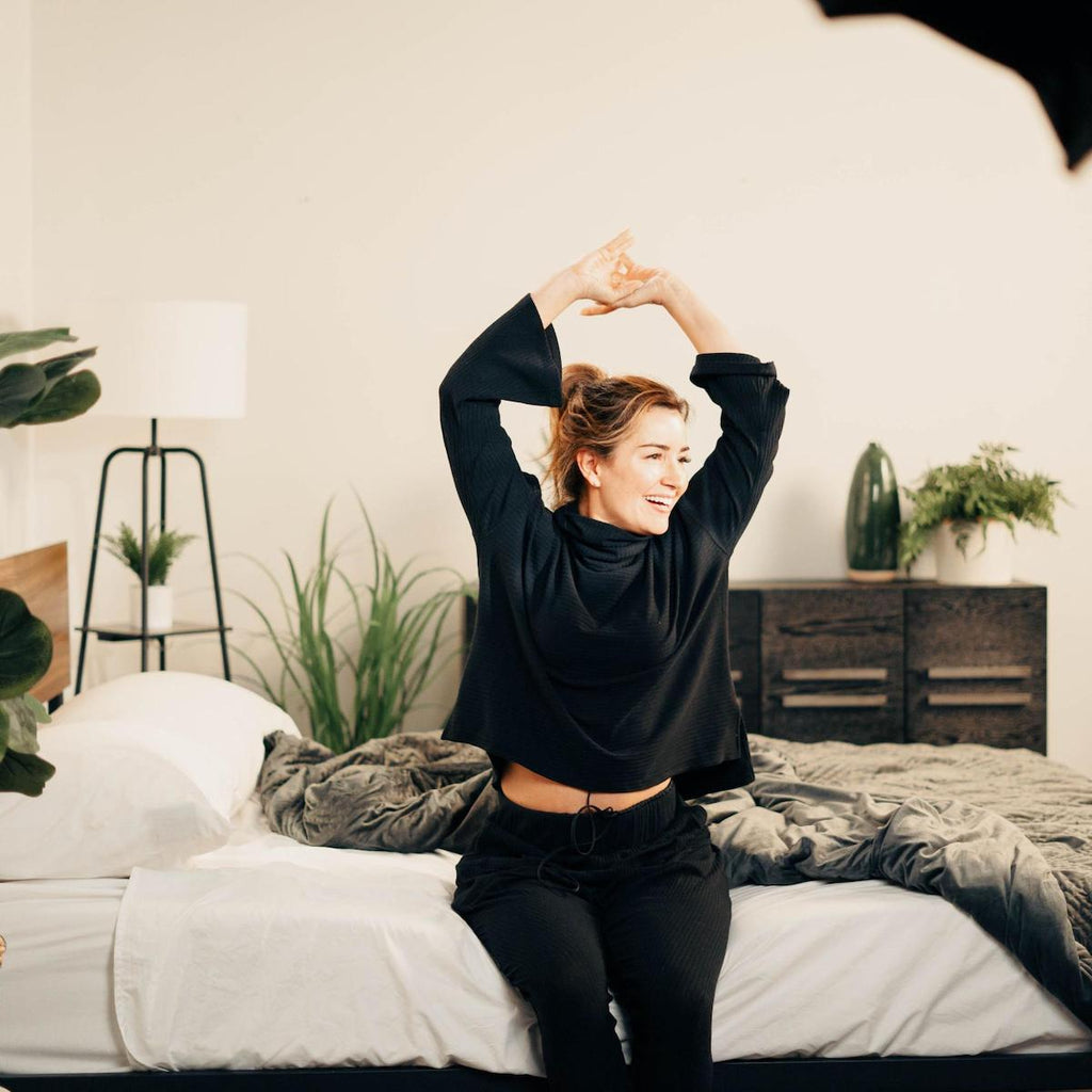 tossing and turning: woman stretching