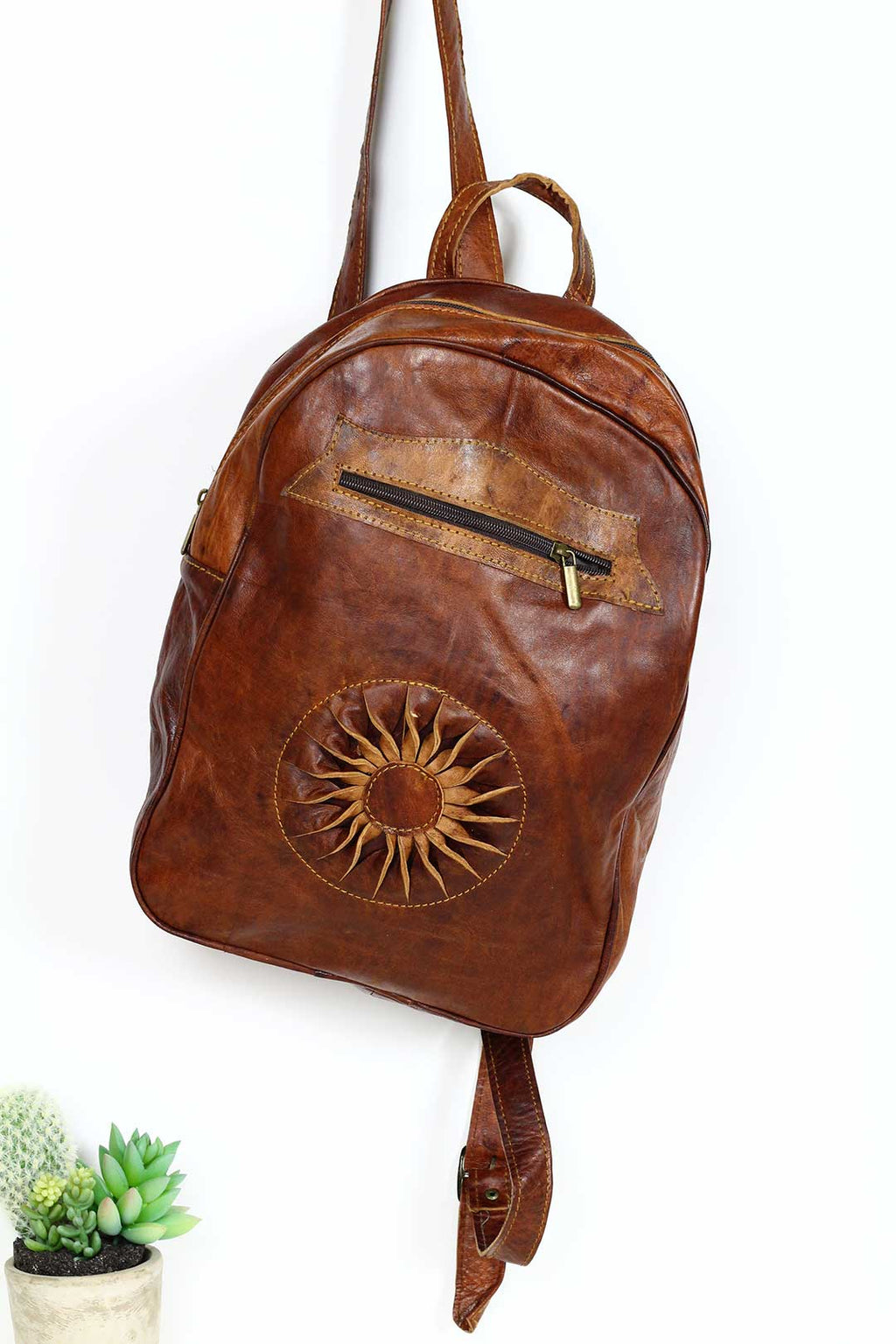 chestnut sun leather backpack