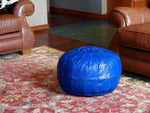 blue leather pouf
