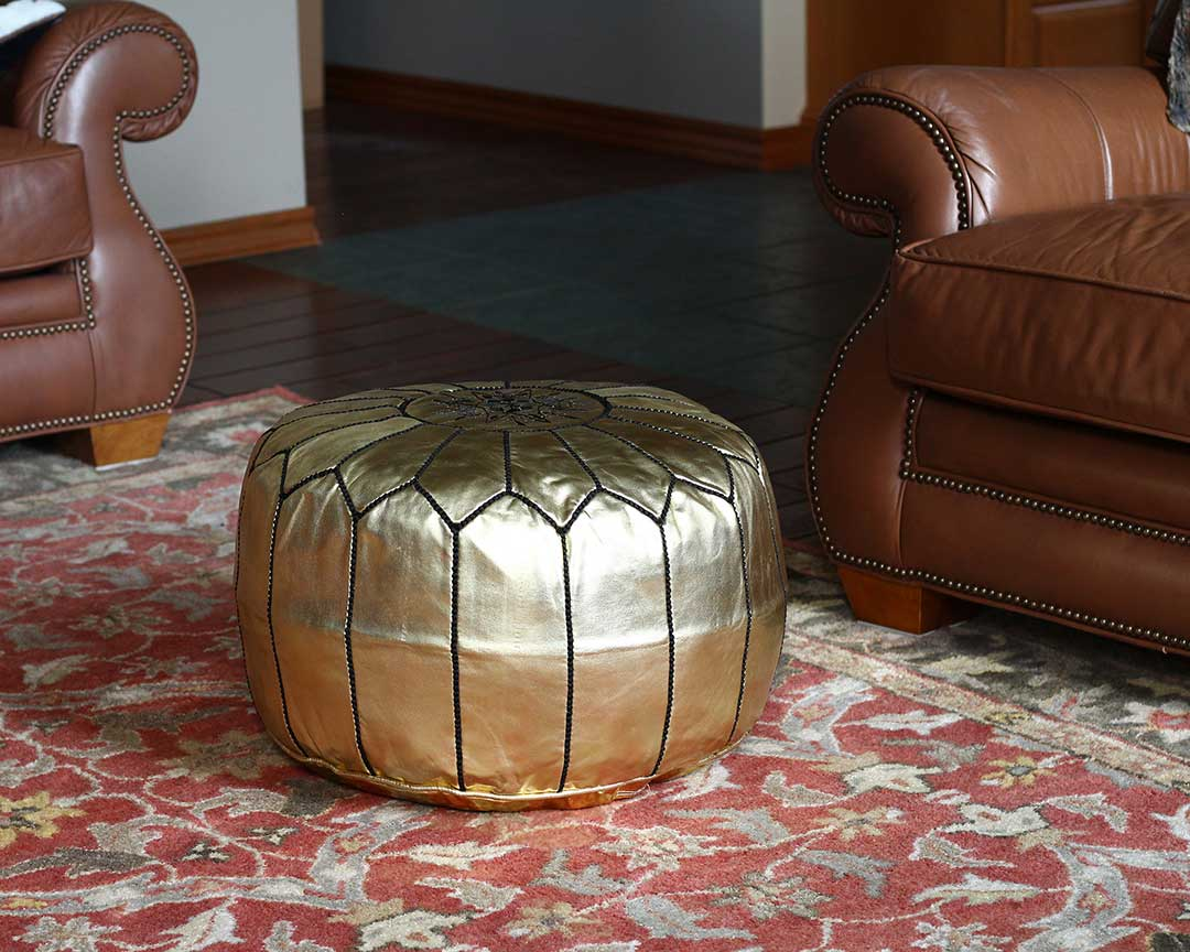 gold with black stitching moroccan leather pouf