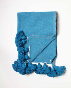 turquoise throw pompom blanket