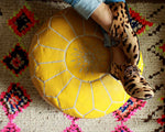 yellow leather ottoman