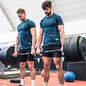 Two Men Deadlifting in Gym+Coffee T-Shirts