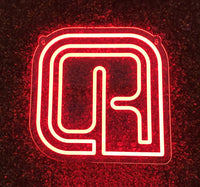 'R' neon sign wall mounted