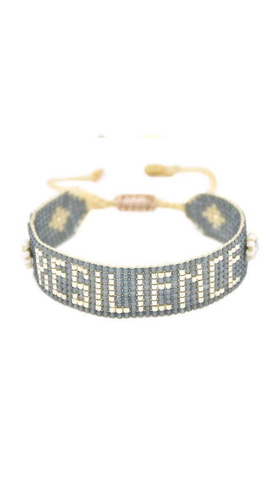 Resilience Mishky Bracelet by Mishky Handed beaded with storm gray glass beads with 3D flowers and metallic lettering