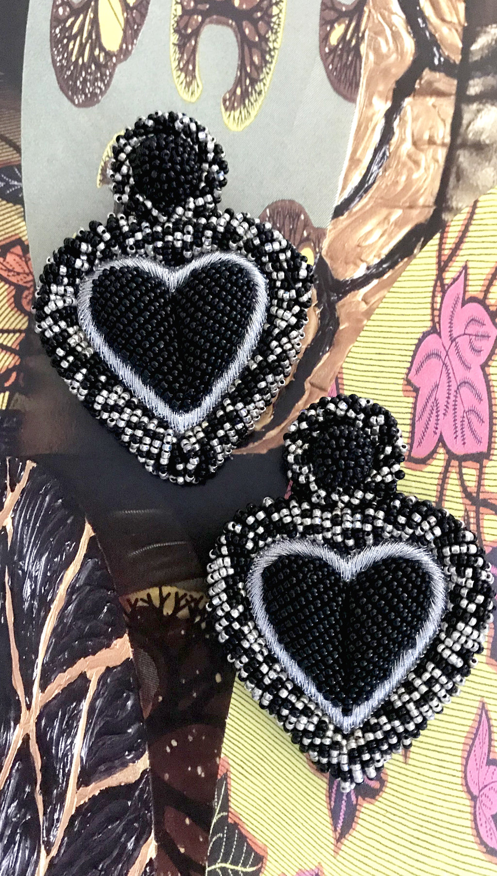 Black Silver Beaded Heart Earrings by Olivia Dar