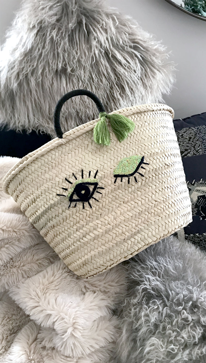 Large winking eye straw bag