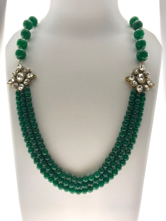 Attractive Three Line Green Ensemble with Kundan Motifs (22 Inches) - Starjewels