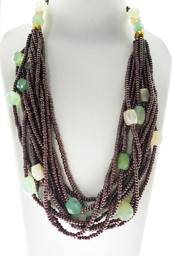 Charming Aqua Onyx and White Agates Necklace Adorned in an Eleven Line Bead Ensemble  (28 Inches)