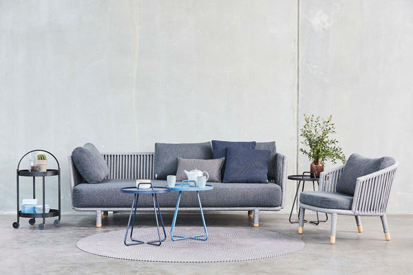 Outdoor lounge sofa with side tables and outdoor carpet