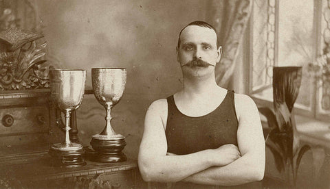 So, you think this guy looks like a cross-eyed dweeb with a peculiar moustache? Think again! See those trophies? This guy is a winner! Through his veins flows red oceans of hardihood and vigor, chummed with Testosterone!