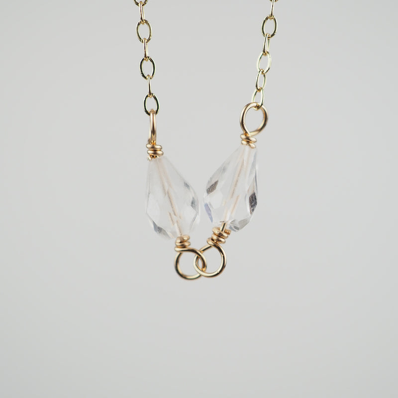 Close-up of the Faceted Teardrop Quartz Crystals on delicate chain necklace
