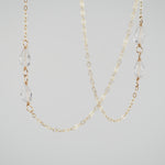Close-up of the Delicate Chain and Quartz Crystals on the Mykonos Necklace