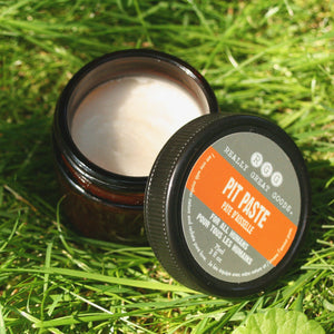Open jar of Pit Paste in grass by Really Great Goods