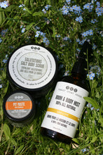 pit paste, salt body scrub and lem love room & body spray by Really Great Goods in grass with small flowers