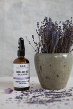 Lav Lime Room & Body Mist with pot of dried lavender branches and lavender flowers scattered around