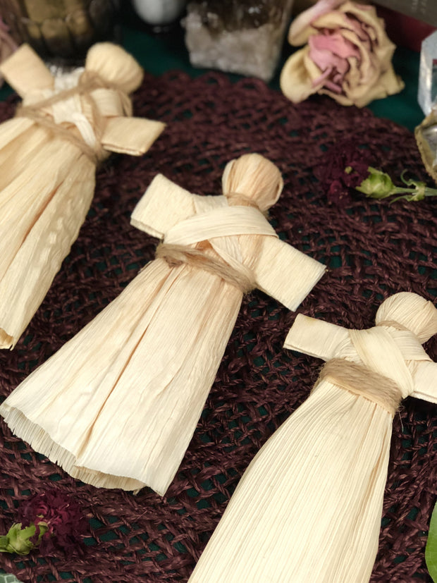 Corn husk dolls on display.