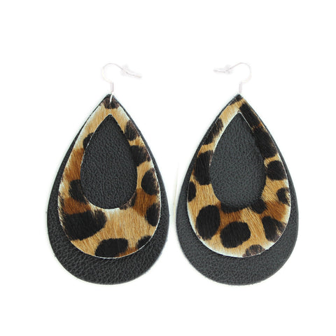The Double Eclipse Leather Earrings in Leopard over Black.