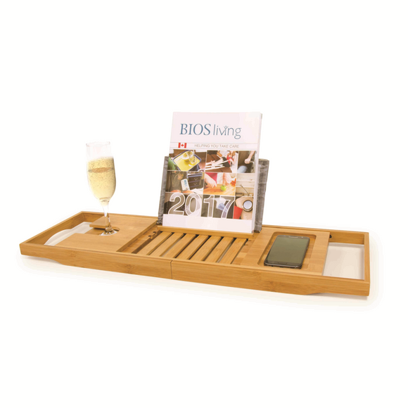 Bamboo Bathtub Caddy with a magazine and glass of champagne