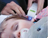 Toddler having Ear Temperature taken