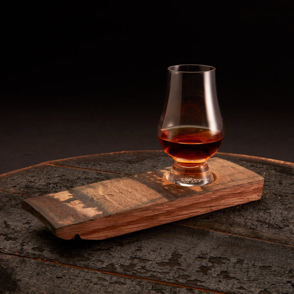 single whiskey flight board with whiskey glass