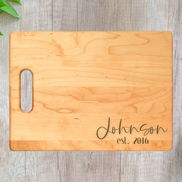 personalized cutting board laying on table