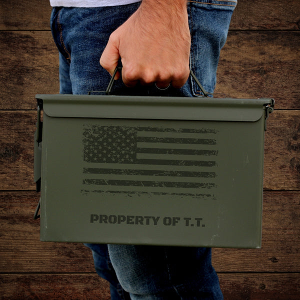 man holding engraved ammo can with American flag