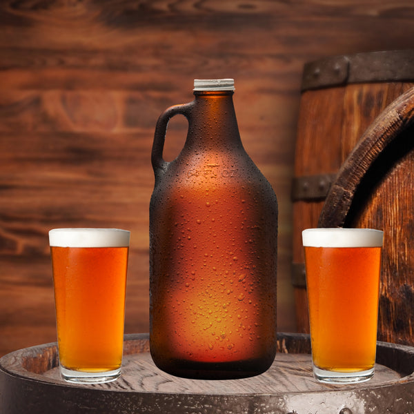 growler with two pints glasses sitting on whiskey barrel