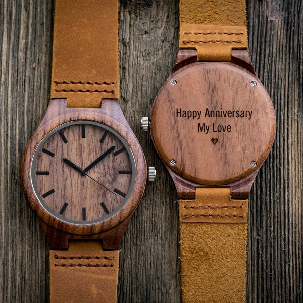 engraved wood watch on wood background